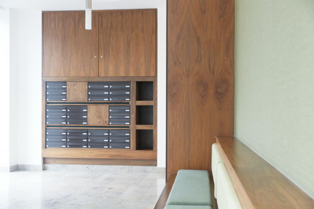 Belfast | Titanic Quarter | Recessed mailboxes in bespoke wood furniture