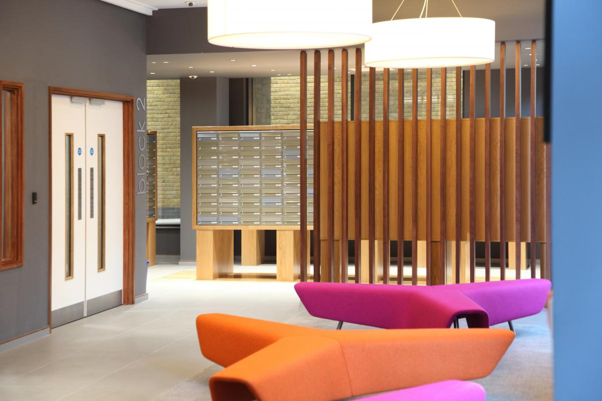 Multiple mailboxes with bespoke timber surround for student accommodation
